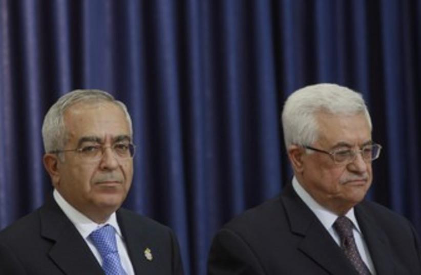 PA President Abbas and PM Fayyad 370 (R) (photo credit: Fadi Arouri / Reuters)