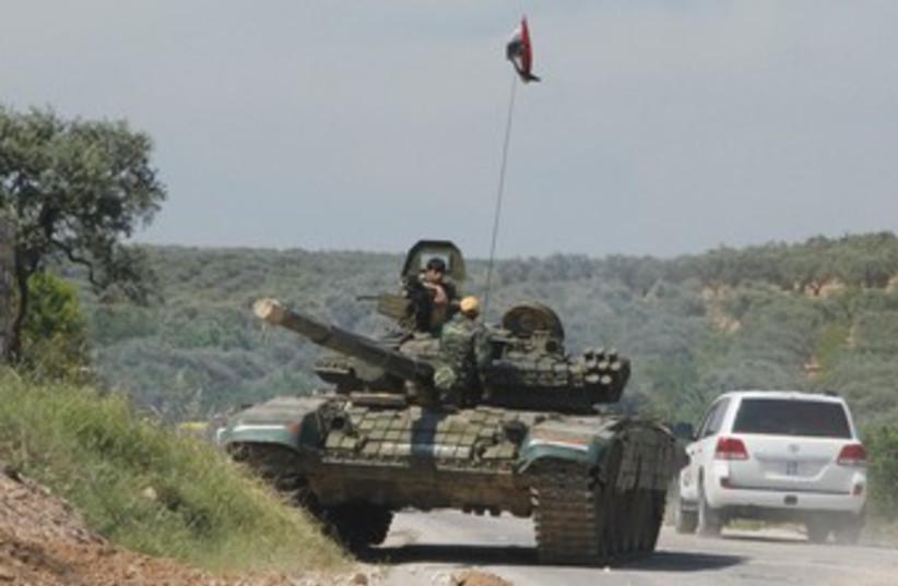 Syrian tank (photo credit: Reuters)