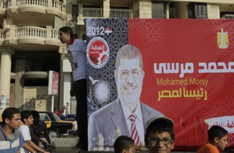 Supporters of Mursi, head of Brotherhood political party 37 (photo credit: REUTERS)