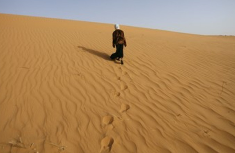 A girl walks near Ouled Said ksar, Sahel_370 (photo credit: Zohra Bensemra/Reuters)