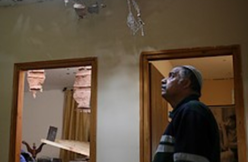 Sderot hole in roof 224 (photo credit: Ariel Jerozolimski)