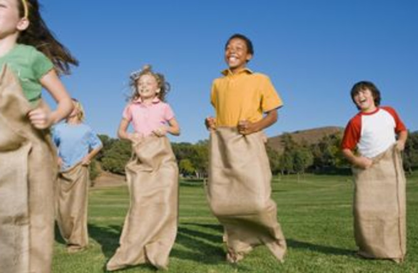 Kids engaging in physical education (photo credit: Thinkstock)