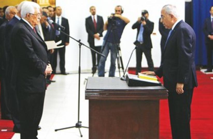 PA PRIME MINISTER Salam Fayyad sworn in 370 (photo credit: Mohamad Torokman/Reuters)