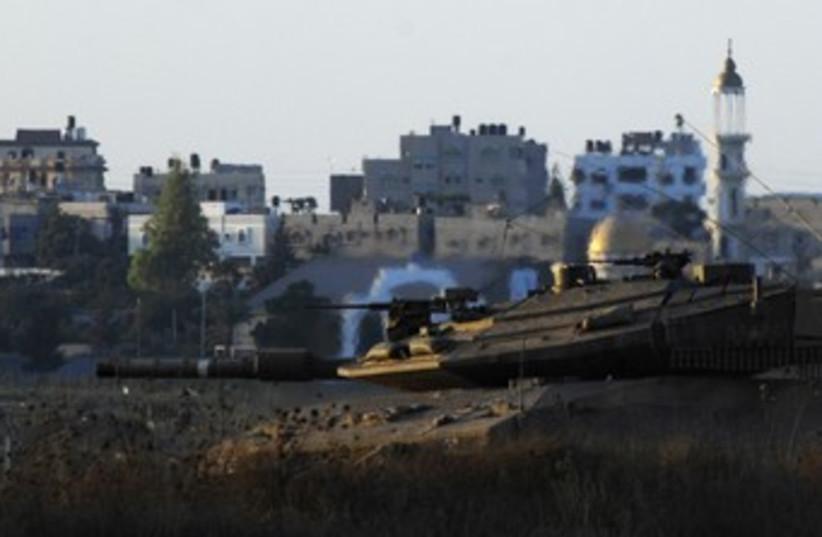 IDF tank in central Gaza Strip_370 (photo credit: Amir Cohen/Reuters)