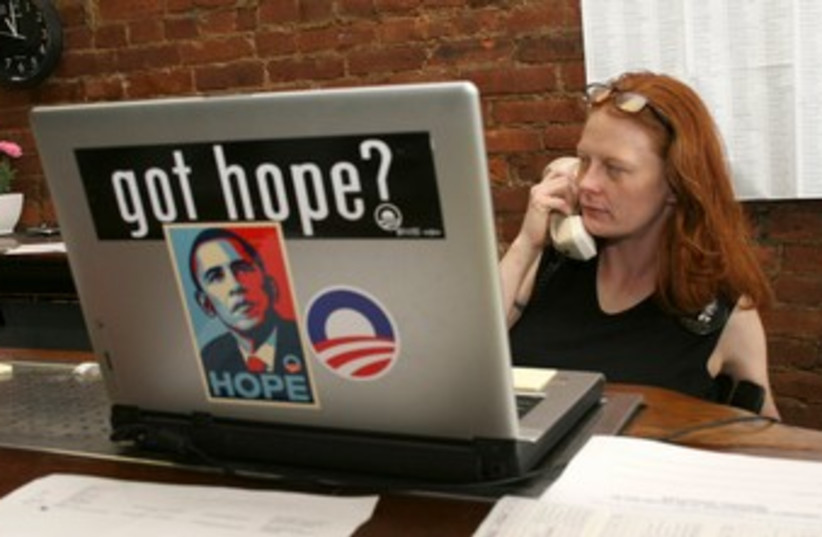 Obama campaign volunteer 370 (R) (photo credit: REUTERS/Frankie Steele)