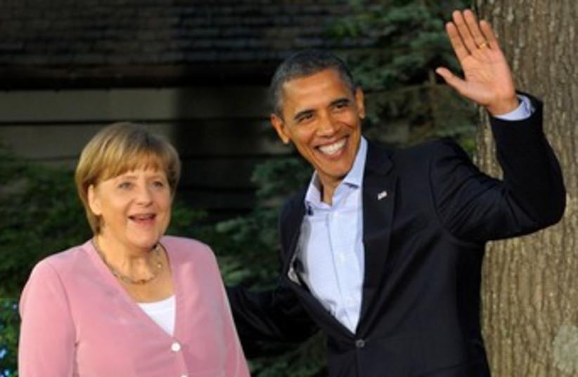 Obama greets Merkel at G8 370 (photo credit: REUTERS/Philippe Wojazer )