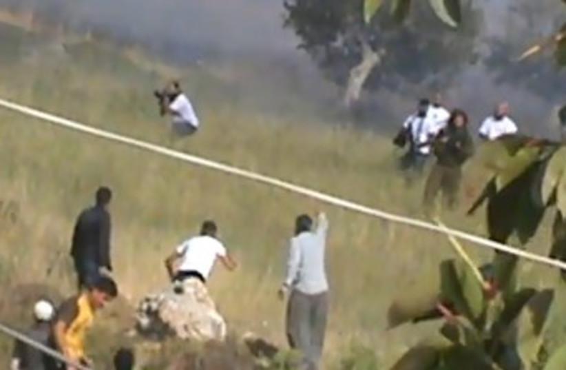 Screenshot of settler, Palestinian clash 370 (photo credit: Screenshot)