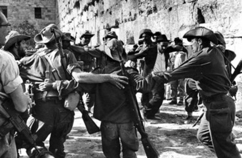 IDF soldiers celebrate at the Western Wall in 1967_370 (photo credit: Courtesy Werner Braun/Jerusalem Post Archives)