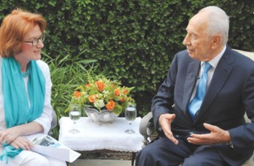 WINSTON CHURCHILL'S granddaughter with Shimon Peres 370 (photo credit: Marc Neiman/GPO)