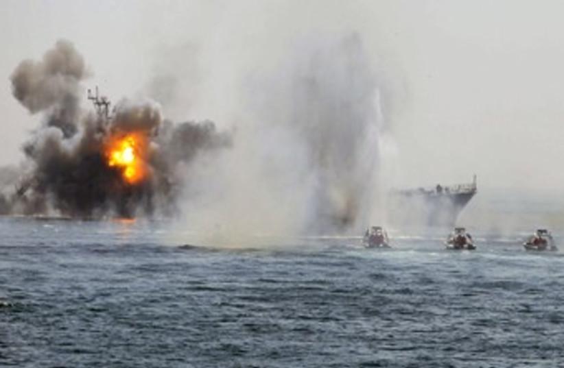 Iranian warship, speed boats in Hormuz war game 370 (photo credit: REUTERS/Fars News)