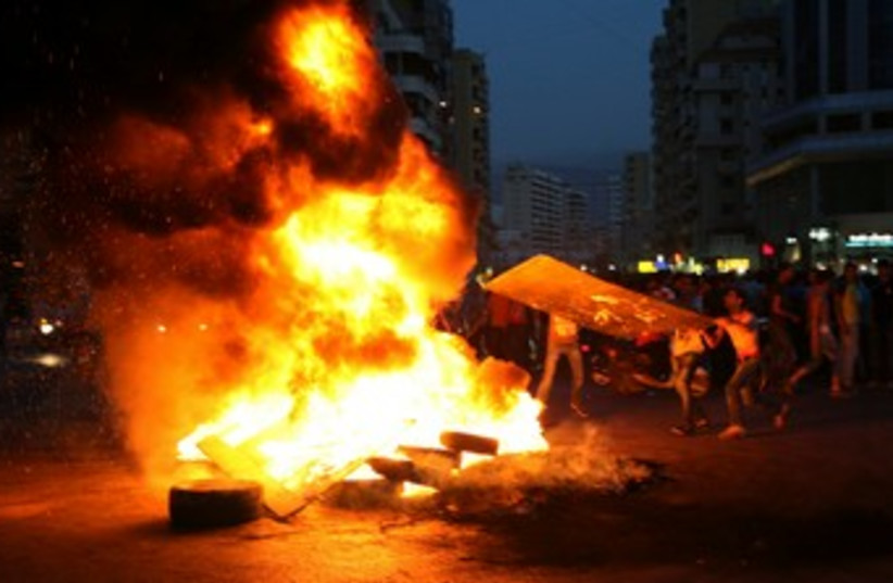 Lebanese Shi'ites protest  370 (photo credit: REUTERS)