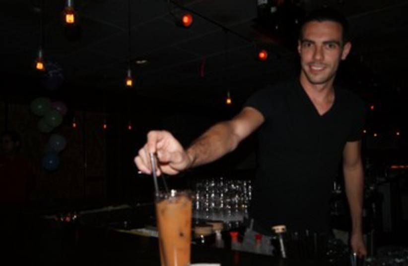 Barman at Evita 370 (photo credit: Yoni Cohen)