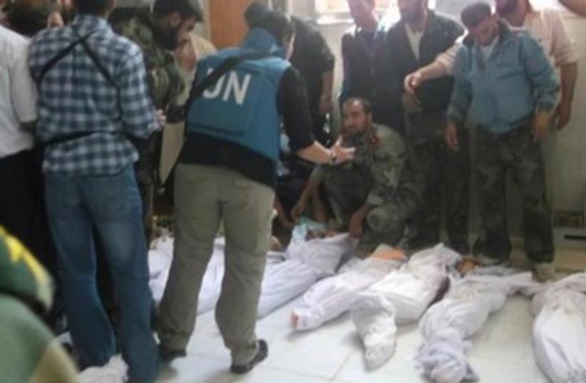 UN observer at scene of Houla massacre 370 (photo credit: REUTERS)