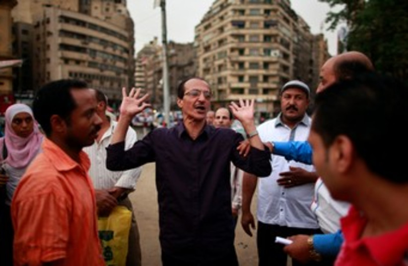 Egyptians argue elections in Tahrir Square 370 (photo credit: REUTERS)