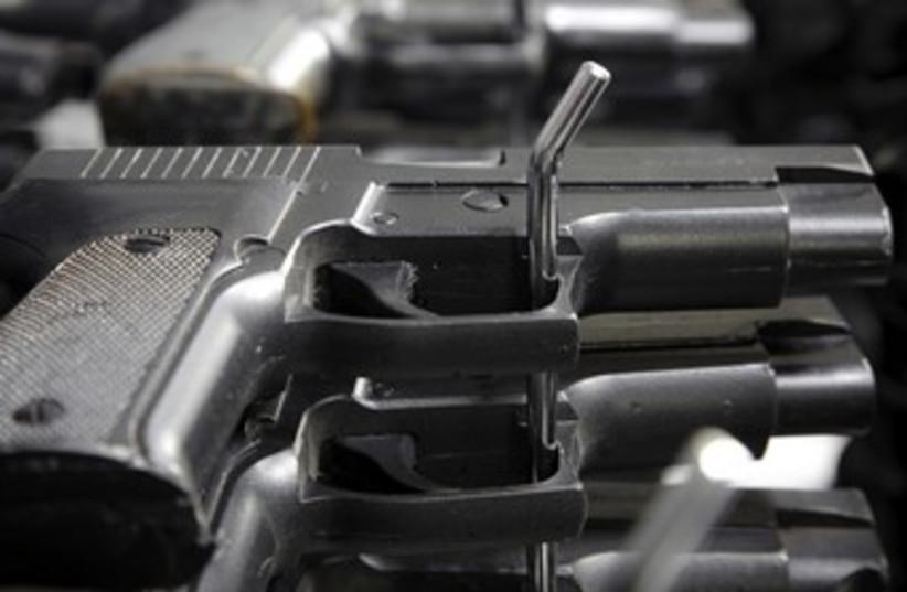Guns 370  (photo credit: Thinkstock/Imagebank)