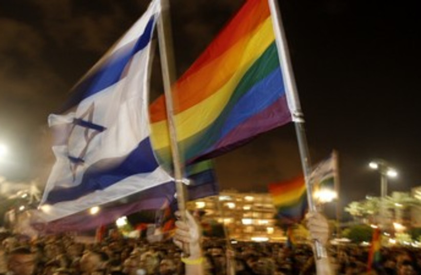 Gay Pride flags 370 (photo credit: Ronen Zvulun / Reuters)