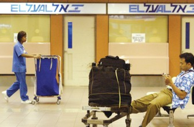 El-Al passengers waiting to board flight 370 (photo credit: Sukree Sukplang/Reuters)