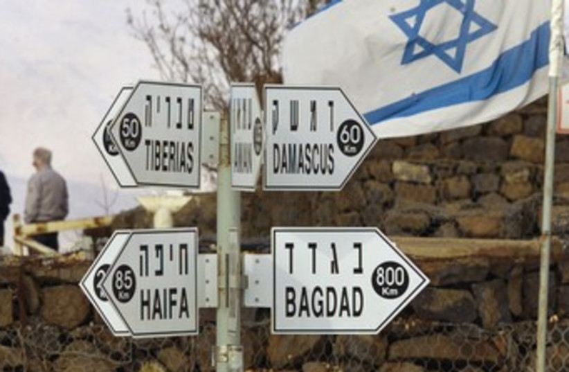 Signposts atop the Golan Heights 370 (photo credit: Reuters)