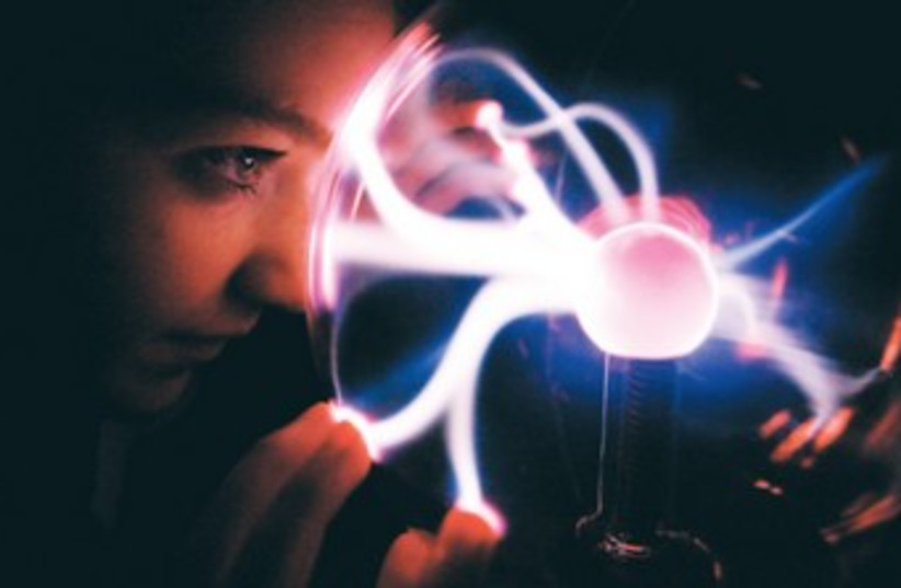 GEMMA MCINLAY looks into a plasma ball 370 (photo credit: REUTERS/Stringer Iran)