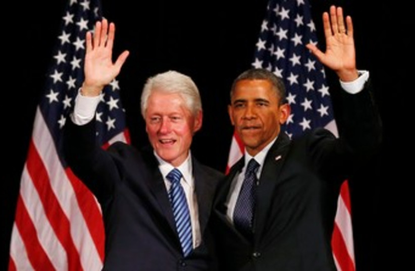 Bill Clinton and US President Barack Obama at fundraiser 370 (photo credit: REUTERS)