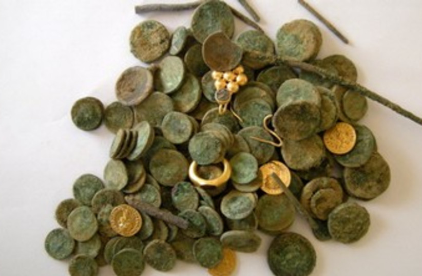 Hoard of treasure discovered near Kiryat Gat 370 (photo credit: Sharon Gal, courtesy of the Israel Antiquities Aut)