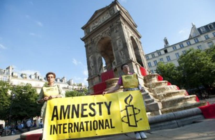 Amnesty International activists 370 (photo credit: REUTERS/Julien Muguet)