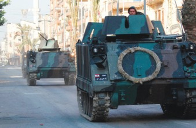 Tanks on the streets of Tripoli in Lebanon 370 (photo credit: Reuters)