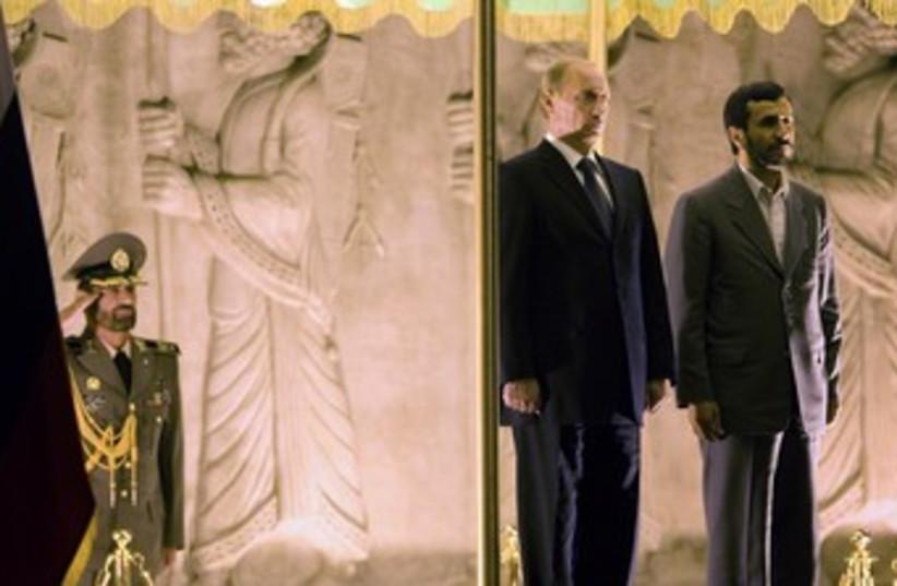 Russia's Putin with Iran's Ahmadinejad 370 (photo credit:  REUTERS/Morteza Nikoubazl)