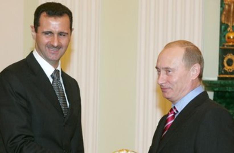 Assad and Putin 370 (photo credit: REUTERS/FILE)