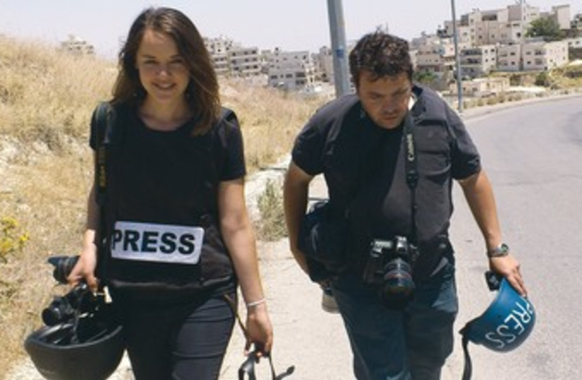 Photographer Marc Sellem, video journalist Hadas Parush  (photo credit: Melanie Lidman)