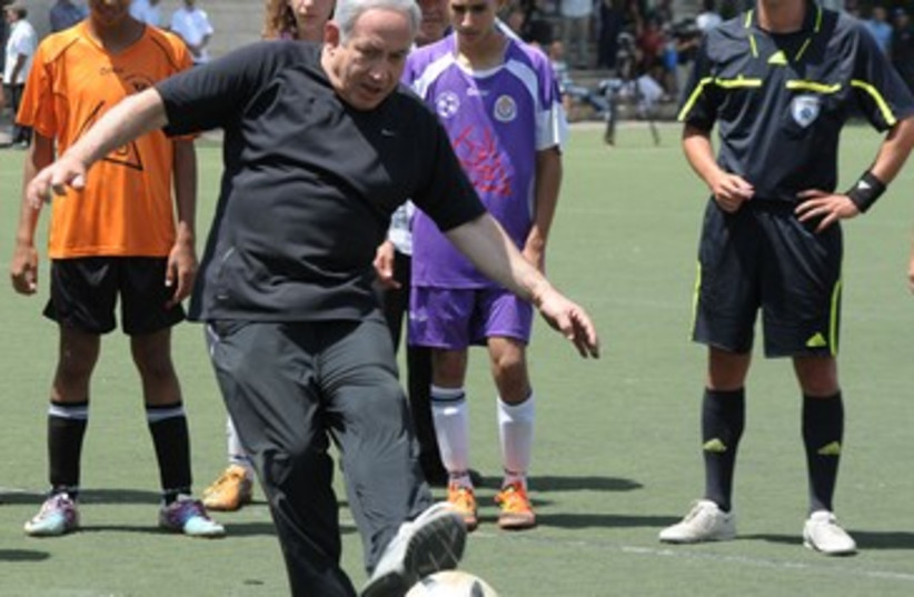 Netanyahu at joint Arab-Jewish soccer game 370 (photo credit: Moshe Milner GPO)