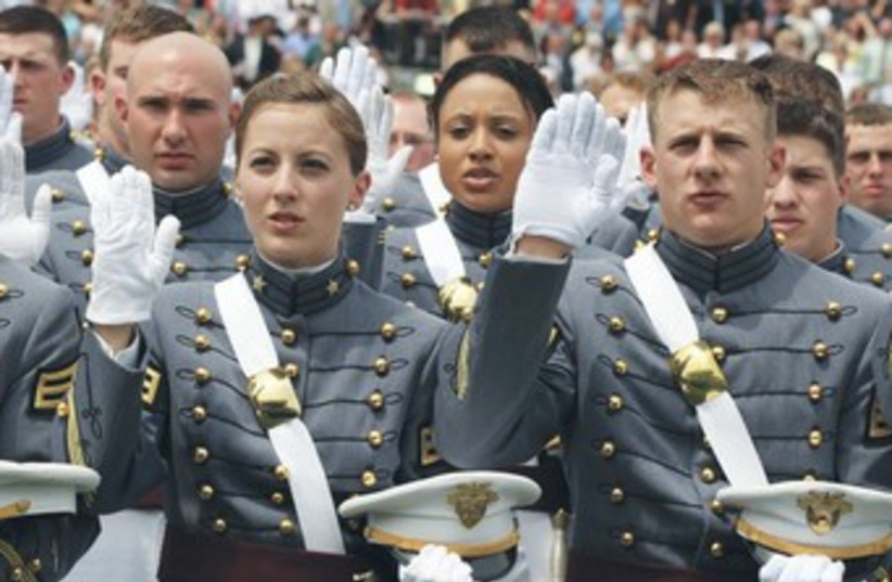 Woman being sworn in (photo credit: REUTERS)