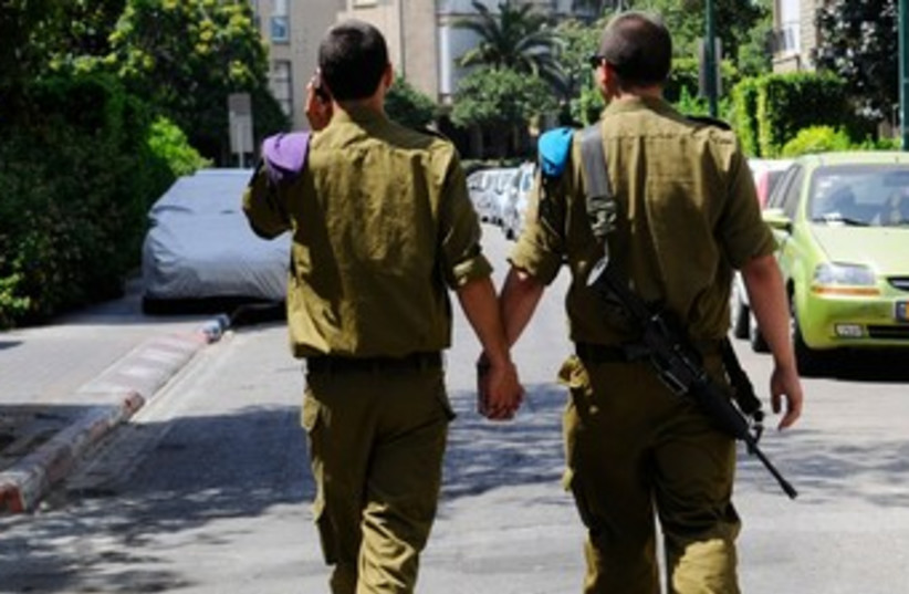 Two male soldiers holding hands in TA 370 (photo credit: IDF)