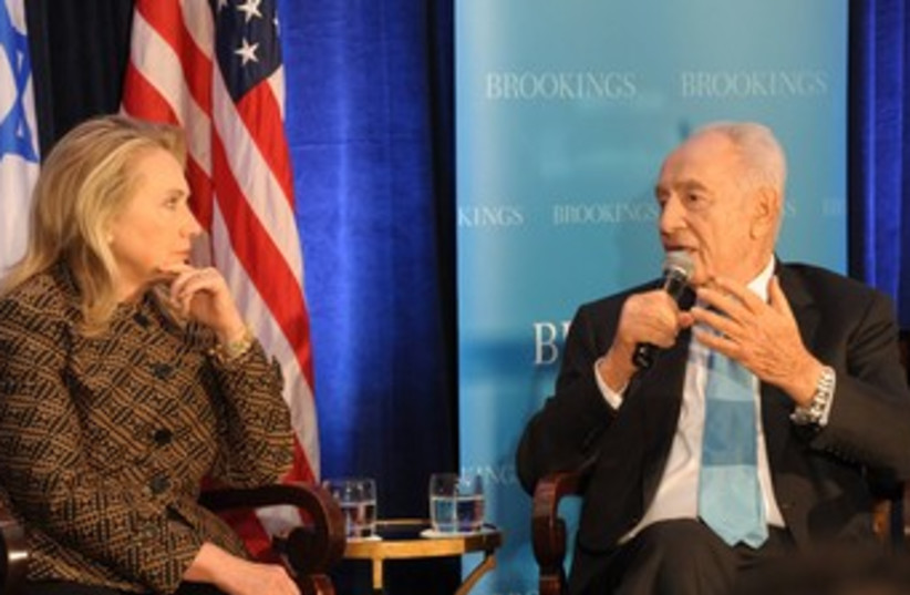 President Peres and US Secretary of State Clinton 370 (photo credit: Amos Ben Gershom / GPO)