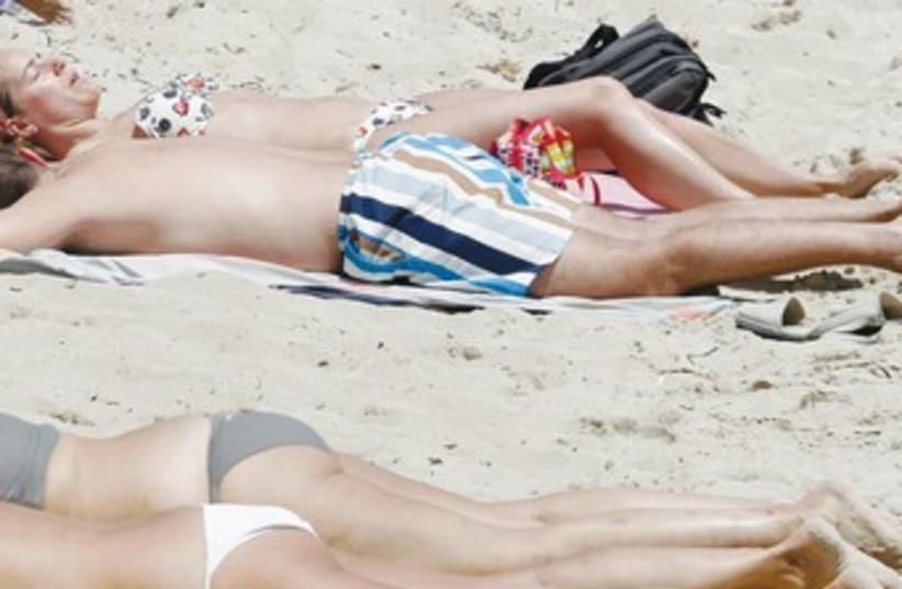 Sunbathing (photo credit: REUTERS)