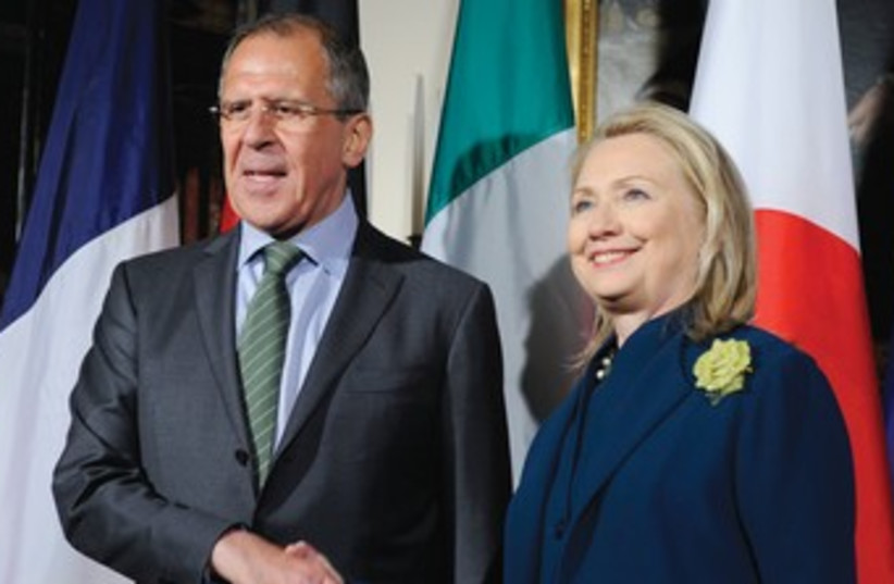 Hillary Clinton with Russian FM Sergei Lavrov 370 (R) (photo credit: Mike Theiler/Reuters)