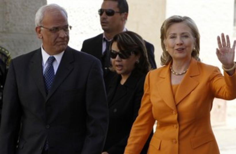 Hillary Clinton and Saeb Erekat meet in Ramallah [file] 370R (photo credit: Ammar Awad / Reuters)