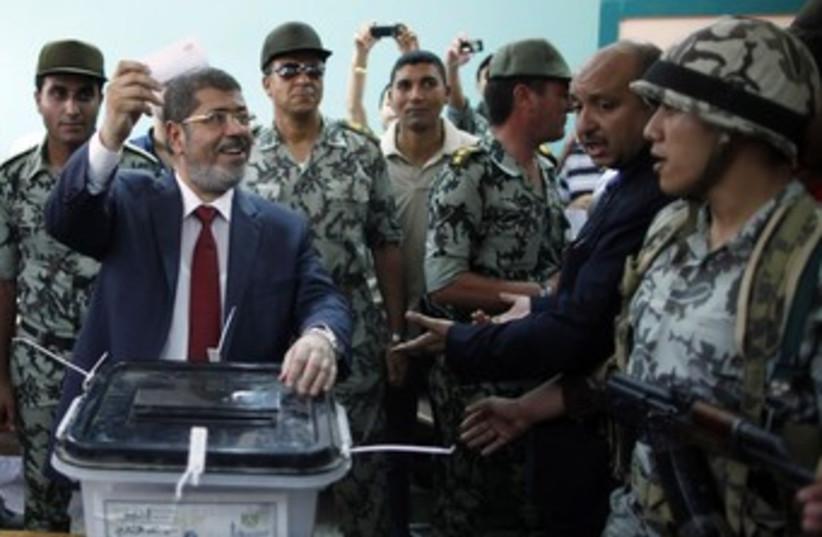 Muslim Brotherhood candidate Mohamed Mursi 370 (photo credit: REUTERS)