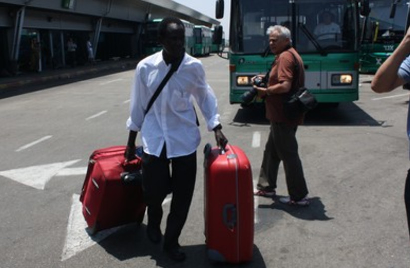 South Sudanese man with suitcases prior to deportation (photo credit: Ben Hartman)