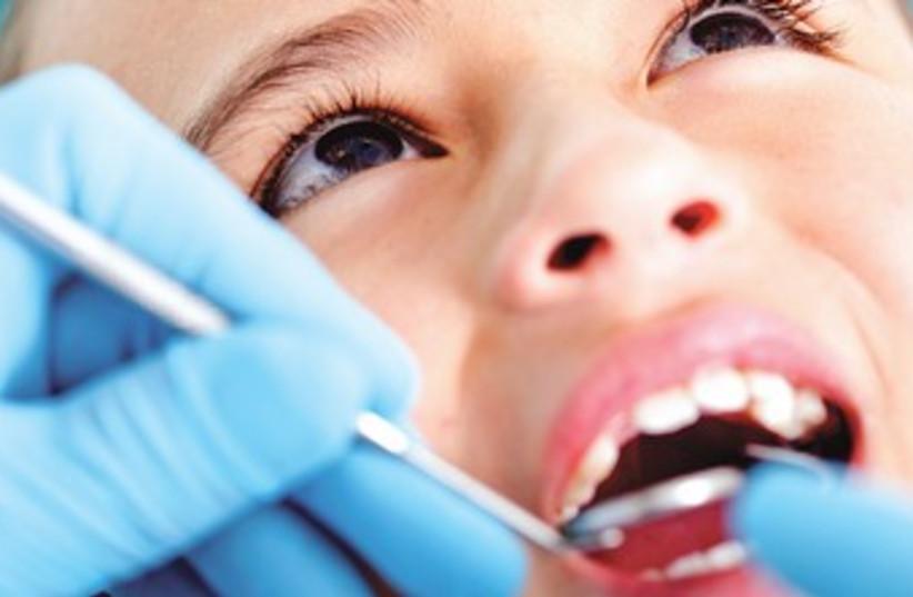 Child at the dentist 370 (photo credit: Thinkstock)