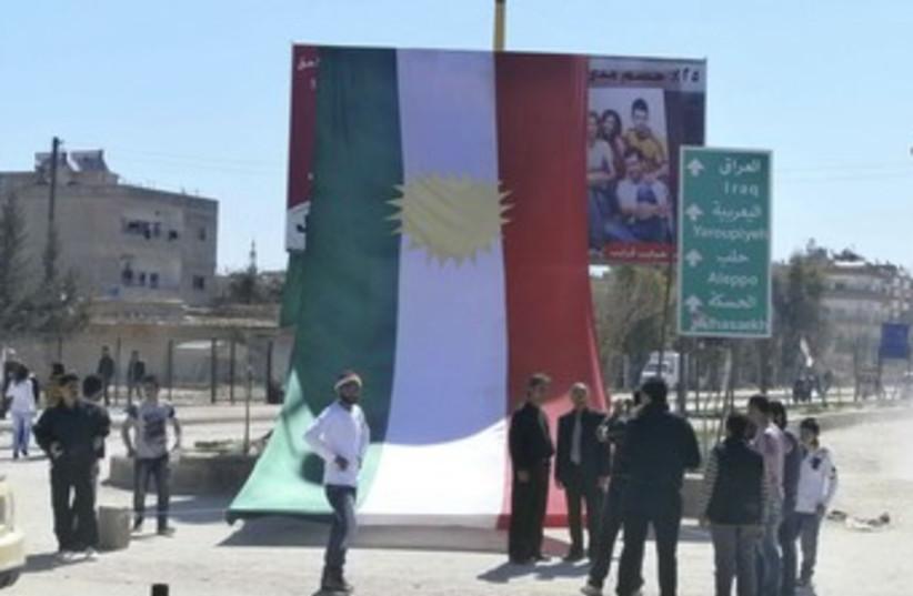 Kurds erect large Kurdistan flag in Syria protest 370 (photo credit: REUTERS/Handout .)