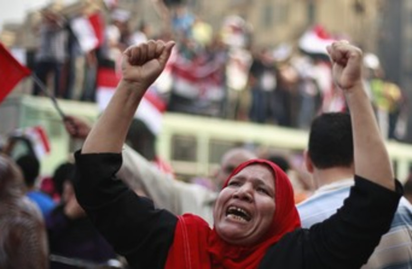 Supporters of Morsy celebrate self-declared vote win 37 (photo credit: REUTERS/Suhaib Salem)