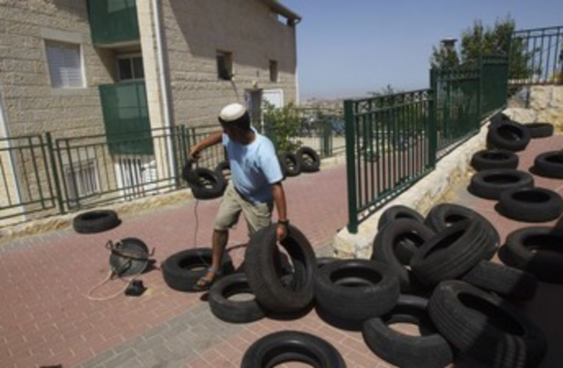 Ulpana tires 370 (photo credit: REUTERS)