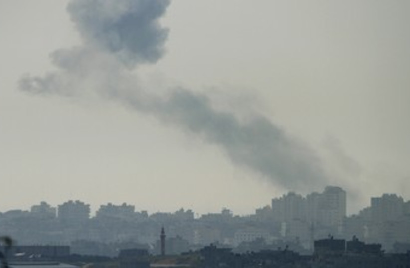 Smoke rises in Gaza after IAF air strike 370 (R) (photo credit: Amir Cohen/Reuters)