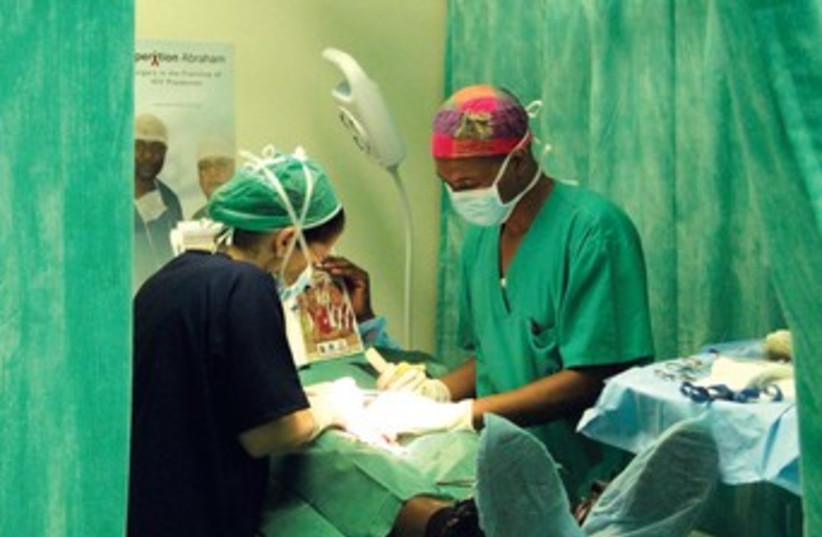 Doctors perform circumcision 370 (photo credit: Courtesy Operation Abraham)