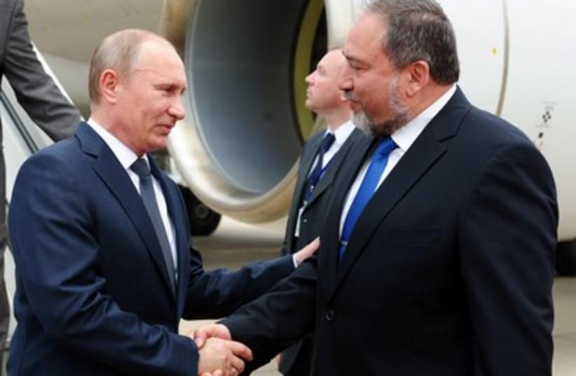 FM Liberman (right) greets Putin at airport