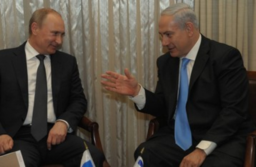 Netanyahu and Putin 390 (photo credit: Amos Ben Gershom / GPO)