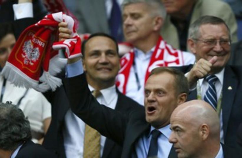 Polish Prime Minister Donald Tusk 370 (R) (photo credit: Kai Pfaffenbach / Reuters)
