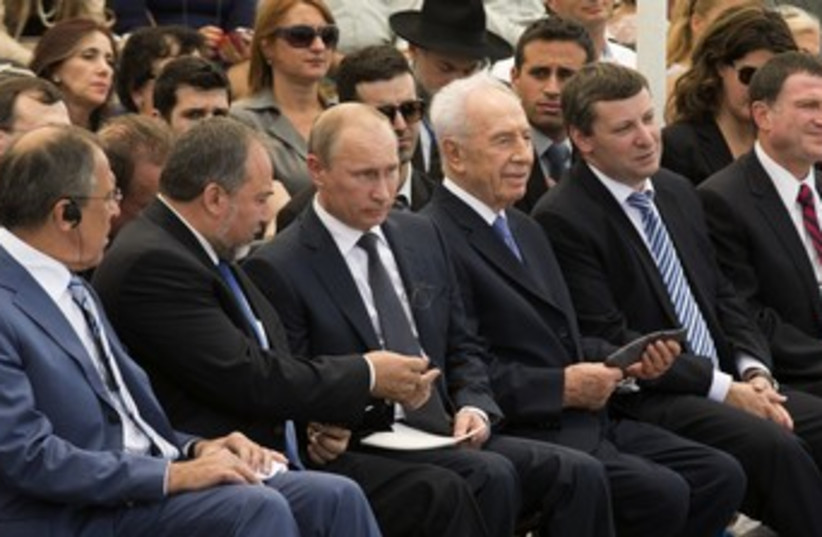 Russian President Putin attends ceremony 370 (photo credit: POOL New / Reuters)