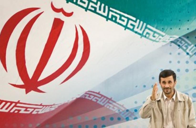 Ahmadinejad behind massive Iranian flag 370 (photo credit: REUTERS/Raheb Homavandi)